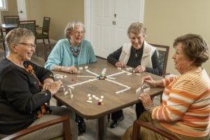 Dominoes (or Mexican Train) is one of our residents' favorite activities at Woodlands