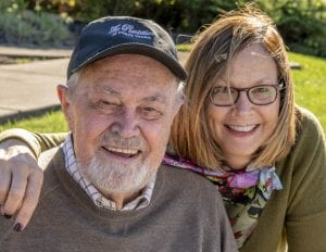 Lynn (right) is happy that her dad, Bob Gremp, chose the Chestnut home at Woodlands for his second home. The biggest benefit is that he'll enjoy the peace of mind of continuing care.
