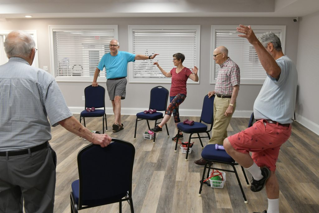 Residents take part in a balance class, a key part of the Woodlands Wellness programming.