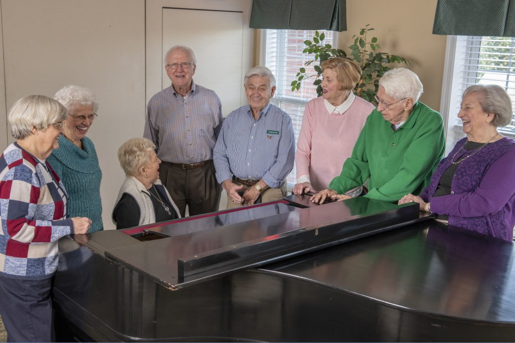 Charles and friends playing piano at Woodlands